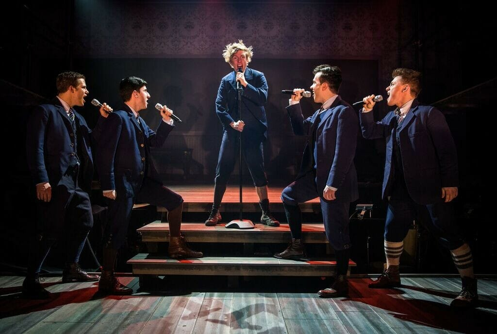 Ben Barker and the male cast